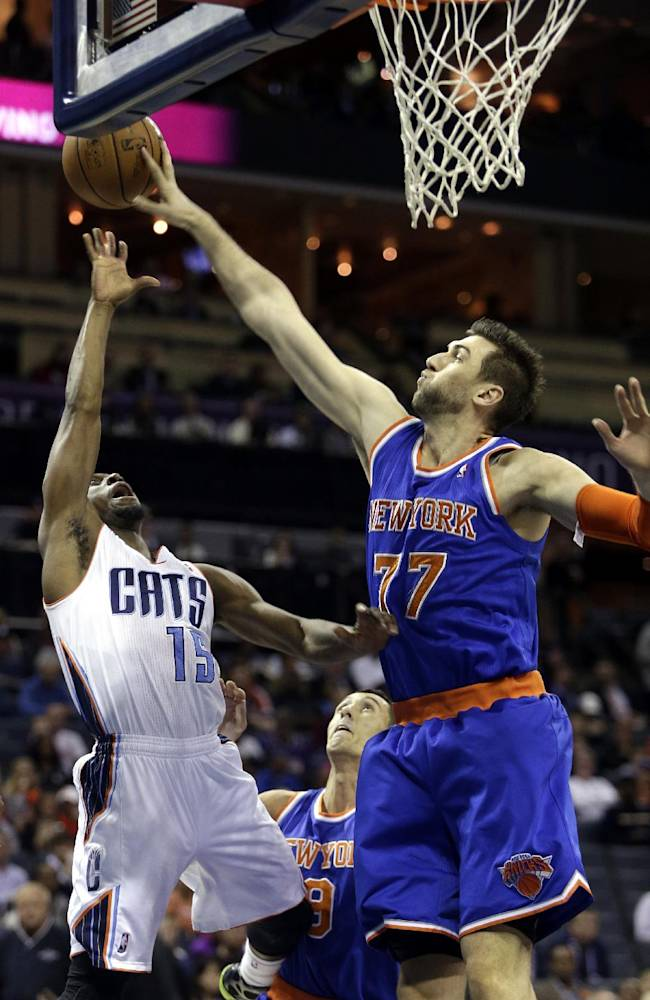 New York Knicks forward Andrea Bargnani, right, of Italy, blocks the shot of Charlotte Bobcats guard Kemba Walker in the first half of an NBA basketball game in Charlotte, N.C., Friday, Nov. 8, 2013