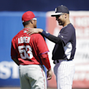 Philadelphia Phillies right fielder Bobby Abreu, left, talks with New York Yankees shortstop Derek Jeter, right, before an exhibition baseball game Saturday, March 1, 2014, in Tampa, Fla The Associated Press