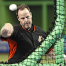 Miami Marlins manager Mike Redmond throws batting practice before a baseball game against the Washington Nationals in Miami, Saturday, Sept. 20, 2014. The Associated Press