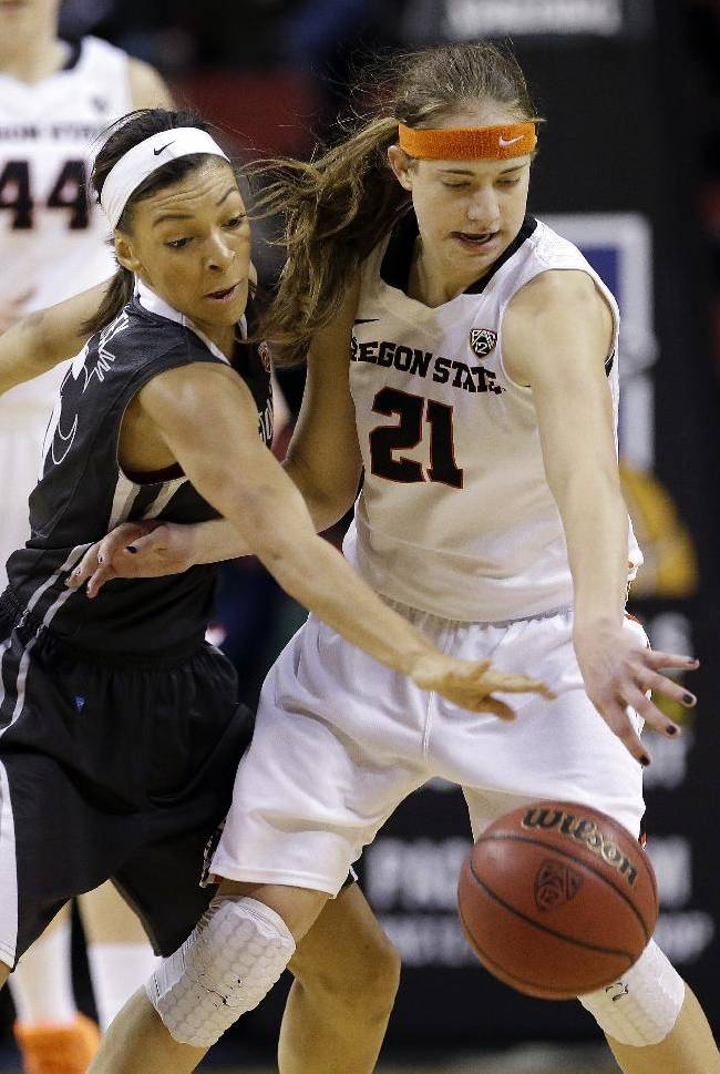 Washington State's Tia Presley, left, tries to knock the ball away from Oregon State's Sydney Wiese in the second half of an NCAA college basketball game in the Pac-12 women's tournament  Saturday, March 8, 2014, in Seattle. Oregon State won 70-60