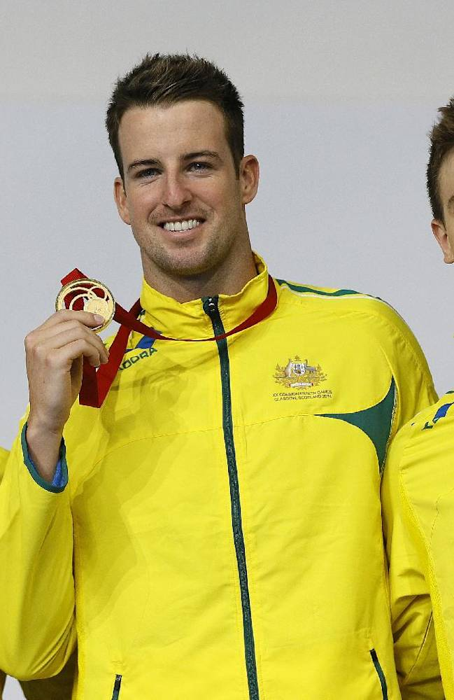 Silver medalist Cameron Mcevoy, left, gold medal James Magnussen, center, and bronze medal Tommaso D'orsogna, all from Australia, pose for photographers after the Men's 100m Freestyle swimming competition  at the Tollcross International Swimming Centre during the Commonwealth Games 2014 in Glasgow, Scotland, Sunday July 27, 2014