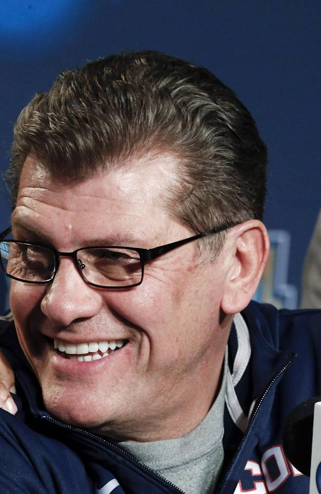 Connecticut head coach Geno Auriemma gets a pat on the shoulder as his players leave a news conference at the NCAA women's Final Four college basketball tournament Monday, April 7, 2014, in Nashville, Tenn. Connecticut is scheduled to face Notre Dame in the championship game Tuesday