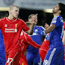 Liverpool's Martin Skrtel, left, gestures toward Chelsea's Diego Costa during the English League Cup semifinal second leg soccer match between Chelsea and Liverpool at Stamford Bridge stadium in London, Tuesday, Jan. 27, 2015