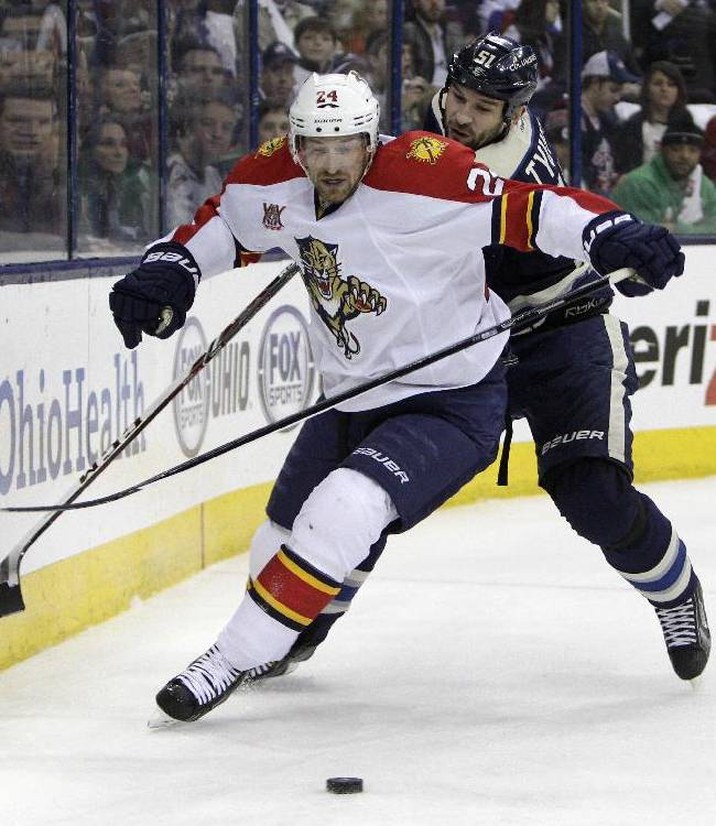 Florida Panthers' Brad Boyes, left, and Columbus Blue Jackets' Fedor Tyutin, of Russia, chase a loose puck during the first period of an NHL hockey game Son aturday, Feb. 1, 2014, in Columbus, Ohio