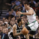 San Antonio Spurs guard Cory Joseph (5) looks to the basket as Boston Celtics center Kris Humphries (43) defends during the second half of an NBA basketball game in Boston, Wednesday, Feb. 12, 2014. The Spurs defeated the Celtics 104-92 The Associated Pre