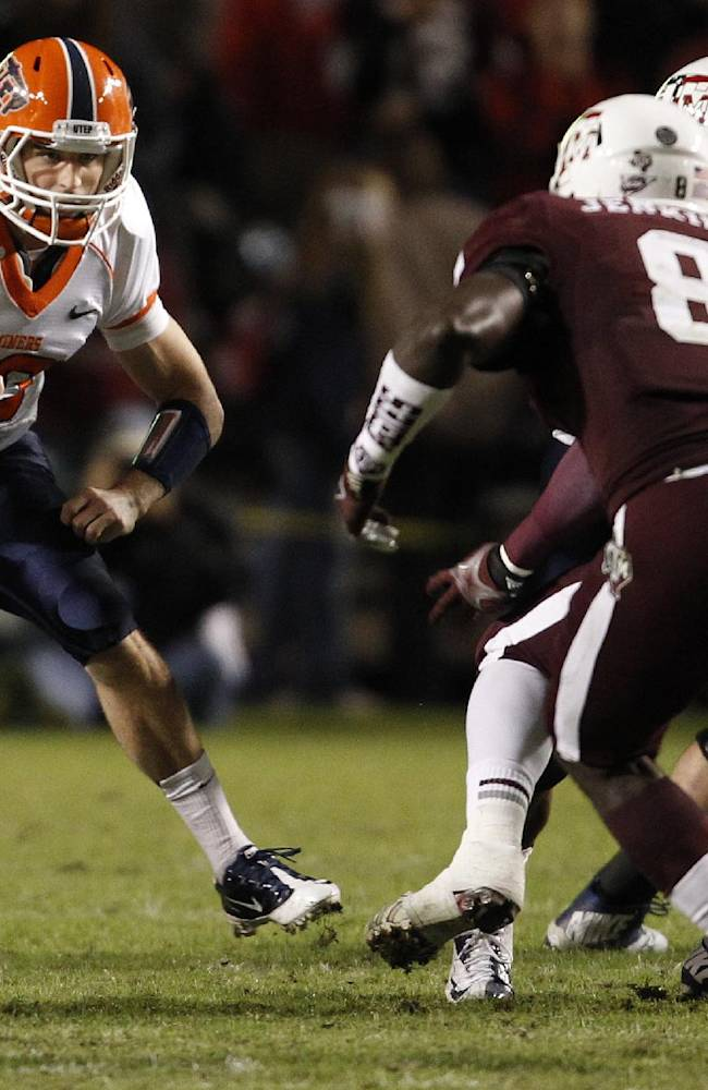 UTEP's Blaire Sullivan, left, runs the ball as Texas A&M's Steven Jenkins (8) defends during the first half of an NCAA football game, Saturday, Nov. 2, 2013 in College Station,Texas
