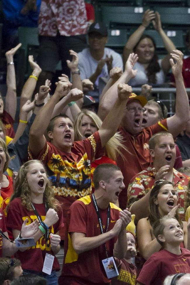 Iowa State fans cheer for their team during the second half of an NCAA college basketball game against Boise State at the Diamond Head Classic on Wednesday, Dec. 25, 2013, in Honolulu. Iowa State defeated Boise State 70-66