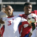 Costa Rica forward Rodney Wallace, right, kicks the ball away from Cuba's Jeniel Molino during the first half of a CONCACAF Gold Cup soccer game in Portland, Ore., Tuesday, July 9, 2013.(AP Photo/Don Ryan)