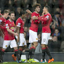 Manchester United's Marouane Fellaini, second right, celebrates scoring with teammates during the English Premier League soccer match between Manchester United and Stoke City at Old Trafford Stadium, Manchester, England, Tuesday Dec. 2, 2014