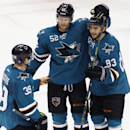 San Jose Sharks' Matt Nieto (83), right, celebrates with teammates Matt Irwin, center, and Logan Couture after scoring a goal against the Anaheim Ducks during the third period of an NHL hockey game, Saturday, Nov. 29, 2014, in San Jose, Calif The Associat