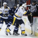 Winnipeg Jets' Mathieu Perreault (85) and Chris Thorburn (22) get sandwiched by Nashville Predators' Viktor Stalberg (25) and Anton Volchenkov (20) during the second period of an NHL hockey game Friday, Oct. 17, 2014, in Winnipeg, Manitoba The Associated