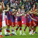Bayern Munich players acknowledge their fans after winning their German Bundesliga first division soccer match against Hertha Berlin in Munich April 25, 2015. REUTERS/Kai Pfaffenbach