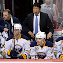 Buffalo Sabres' head coach Ted Nolan stands on the bench behind players Zenon Konopka, from left to right, Cody Hodgson, Matt D'Agostini and Tyler Ennis during third period NHL hockey action against the Vancouver Canucks in Vancouver, British Columbia, on