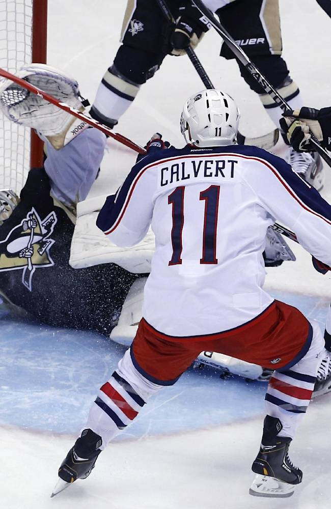 Columbus Blue Jackets' Matt Calvert (11) puts the puck over Pittsburgh Penguins goalie Marc-Andre Fleury (29) for the game-winning goal in the second overtime period of a first-round NHL playoff hockey game in Pittsburgh Saturday, April 19, 2014. The Blue Jackets won 4-3, to even the series at 1-1
