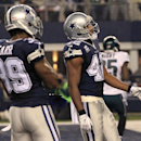 Dallas Cowboys' Brandon Carr (39) and Barry Church stand in the end zone after Philadelphia Eagles' LeSean McCoy scored a touchdown after a long run during the second half of an NFL football game, Thursday, Nov. 27, 2014, in Arlington, Texas The Associate