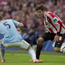 Sunderland's Marcos Alsonso, right, keeps the ball from Manchester City's Pablo Zabaleta during the League Cup Final at Wembley Stadium, London, England, Sunday March 2, 2014