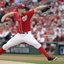 In this Oct. 3, 2014 file photo, Washington Nationals starting pitcher Stephen Strasburg (37) pitches in a baseball game against the San Francisco Giants at Nationals Park in Washington. Strasburg and the Nationals have agreed to a $7.4 million, one-year