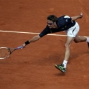 Spain's Tommy Robredo returns the ball to compatriot Nicolas Almagro during their fourth round match of the French Open tennis tournament at the Roland Garros stadium Sunday, June 2, 2013 in Paris. (AP Photo/Michel Spingler)