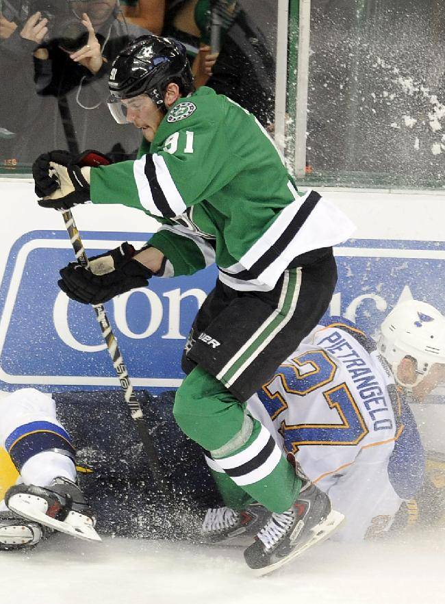 Dallas Stars center Tyler Seguin (91) goes after the puck after checking St. Louis Blues defenseman Alex Pietrangelo (27) in the third period of an NHL hockey game, Sunday, Dec. 29, 2013, in Dallas. The St. Louis Blues won 3-2 in overtime