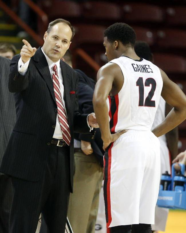 Georgia's head coach Mark Fox talks with player Kenny Gaines during a timeout during an NCAA college basketball game against Nebraska at the Charleston Classic NCAA college basketball tournament in Charleston, S.C., Sunday, Nov. 24, 2013