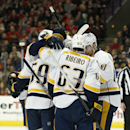 Nashville Predators players gather after teammate Shea Weber (6) scored against the Chicago Blackhawks during the first period of an NHL hockey game on Saturday, Oct. 18, 2014, in Chicago The Associated Press