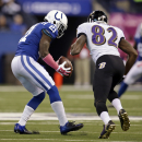 Indianapolis Colts cornerback Vontae Davis, left, intercepts a pass intended for Baltimore Ravens wide receiver Torrey Smith (82) during the second half of an NFL football game in Indianapolis, Sunday, Oct. 5, 2014 The Associated Press