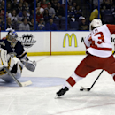 Detroit Red Wings' Darren Helm, right, controls the puck as St. Louis Blues goalie Ryan Miller defends during the first period of an NHL hockey game Sunday, April 13, 2014, in St. Louis The Associated Press