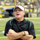 In this Sept. 4, 2010, Oregon coach Chip Kelly calls to his team during an NCAA college football game with New Mexico in Eugene, Ore. Questions at Pac-12 media day about how Oregon and Kelly expect to build on recent success will no doubt be replaced Tuesday, July 26, by questions about the Ducks' relationship with Willie Lyles. The NCAA is investigating whether Oregon broke any rules in its association with Lyles. It would be a violation if he steered a recruit to the Ducks. (AP Photo/Rick Bowmer)