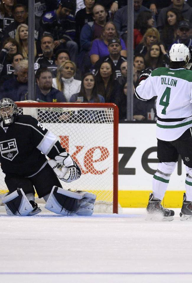 Dallas Stars center Rich Peverley, right, celebrates his goal with teammates defenseman Brenden Dillon, second from left, left wing Jamie Benn, second from right, and center Tyler Seguin as Los Angeles Kings goalie Jonathan Quick, left, looks on during the second period of their NHL hockey game, Saturday, Oct. 19, 2013, in Los Angeles, Calif