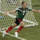 This is a Monday, June 23, 2014 file photo of Mexico's Javier Hernandez, as he celebrates scoring his side's 3rd goal during the group A World Cup soccer match between Croatia and Mexico at the Arena Pernambuco in Recife, Brazil. Real Madrid has signe