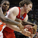 Louisville's Chane Behanan, left, and New Mexico's Cameron Bairstow, right, vie for a rebound in the second half of an NCAA men's college basketball tournament third-round game in Portland, Ore., Saturday, March 17, 2012. Louisville defeated New Mexico 59-56. (AP Photo/Rick Bowmer)
