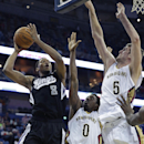 Sacramento Kings forward Rudy Gay (8) goes to the basket against New Orleans Pelicans forward Al-Farouq Aminu (0) and center Jeff Withey (5) in the first half of an NBA basketball game in New Orleans, Monday, March 31, 2014 The Associated Press