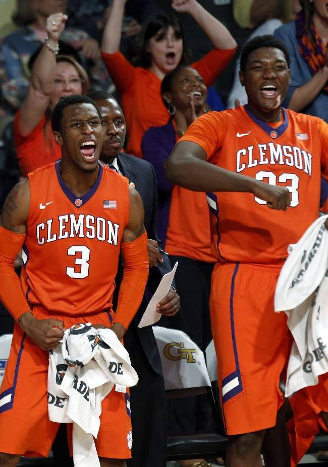Clemson teammates Adonis Filer (3) and  Josh Smith (33) react after a Clemson basket in the second half of an NCAA college basketball game against Georgia Tech  Saturday, Feb. 22, 2014, in Atlanta. Clemson won 63-55