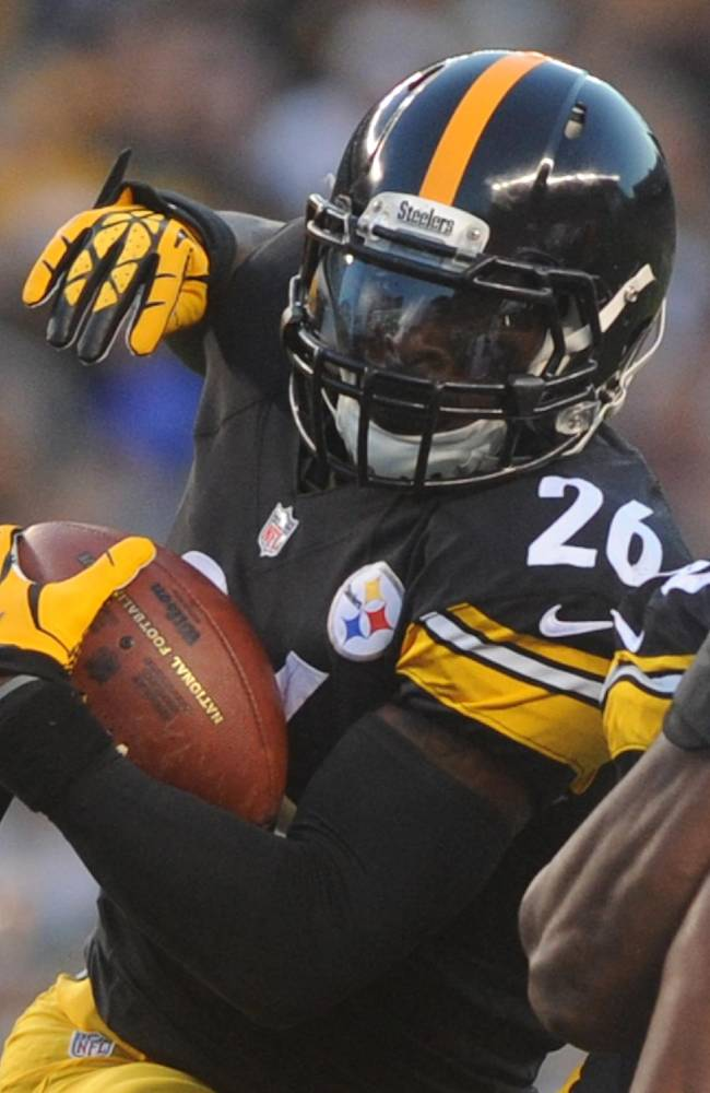 In this Aug. 16, 2014, file photo, Pittsburgh Steelers running back Le'Veon Bell (26) plays in an NFL preseason football game against the Buffalo Bills in Pittsburgh. Steelers running backs Bell and LeGarrette Blount will be charged with marijuana possession following a traffic stop Wednesday afternoon, Aug. 20, 2014, near Pittsburgh. Ross Township detective Brian Kohlhepp said traffic officer Sean Stafiej pulled over a Camaro operated by Bell around 1:30 p.m. after Stafiej, who was on a motorcycle, noticed a strong odor of marijuana coming from the vehicle. Stafiej found a 20 gram bag of marijuana inside the car. Bell, Blount and a female passenger all claimed ownership of the marijuana according to police