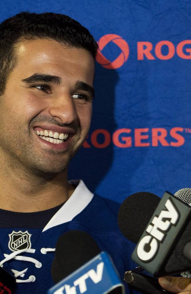 Toronto Maple Leafs NHL hockey forward Nazem Kadri laughs as he speaks to the media on opening day of  training camp in Toronto, Wednesday, Sept. 11, 2013