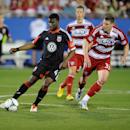 MAY 11, 2013; Frisco, TX, USA; D.C. United defender/midfielder Brandon McDonald (4) and FC Dallas forward Kenny Cooper (33) chase the ball during the game at FC Dallas Stadium. FC Dallas defeated D.C. United 2-1. (Jerome Miron-USA TODAY Sports)