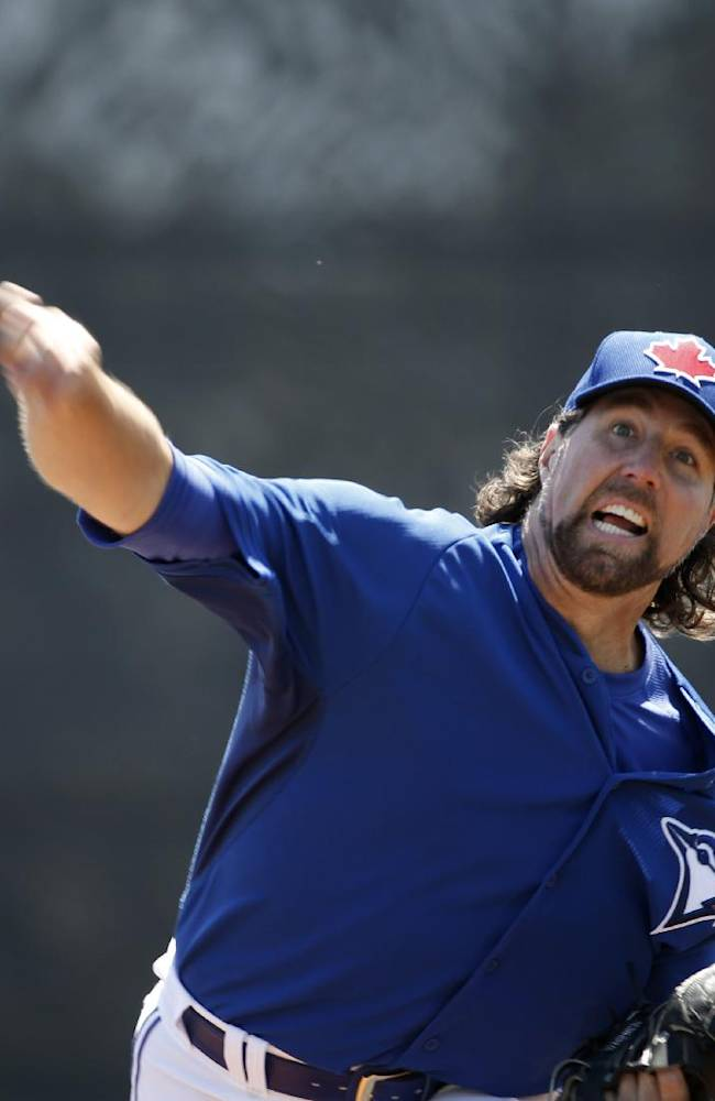 Toronto Blue Jays starting pitcher R.A. Dickey delivers a warmup pitch before starting in a spring training baseball game against the New York Yankees in Dunedin, Fla., Wednesday, March 26, 2014