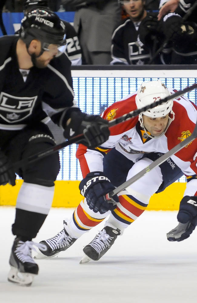 Quick sets wins record, Kings blank Panthers 4-0