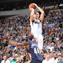 DALLAS, TX - DECEMBER 10: Chandler Parsons #25 of the Dallas Mavericks shoots a jumper against Dante Cunningham #44 of the New Orleans Pelicans on December 10, 2014 at the American Airlines Center in Dallas, Texas. (Photo by Danny Bollinger/NBAE via Getty Images)