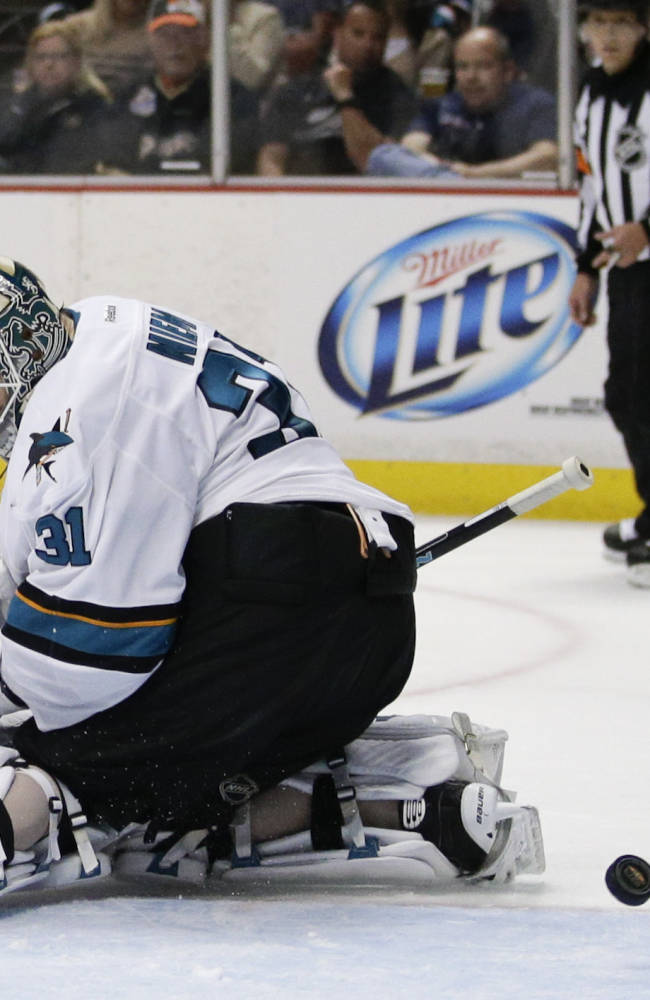 A shot by Anaheim Ducks' Patrick Maroon enters the net past San Jose Sharks goalie Antti Niemi, of Finland, during the second period of an NHL hockey game on Wednesday, April 9, 2014, in Anaheim, Calif
