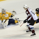 Colorado Avalanche left wing Gabriel Landeskog (92), of Sweden, scores past Nashville Predators goalie Pekka Rinne (35), of Finland, and forward Mike Fisher (12) in the first period of an NHL hockey game on Tuesday, March 25, 2014, in Nashville, Tenn The