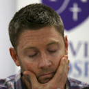 Australia cricket captain Michael Clarke touches his face before reading a statement following the death of fellow cricketer Phillip Hughes during a press conference at St. Vincent's Hospital in Sydney, Thursday, Nov. 27, 2014. Hughes, 25, died in the hos