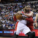 Chicago Bulls guard Kirk Hinrich, right, grabs Washington Wizards guard John Wall during the second half of an NBA basketball game, Saturday, April 5, 2014, in Washington. Hinrich was called for a foul on the play. The Bulls won 96-78 The Associated Press