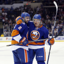 New York Islanders center Mikhail Grabovski (84) of Germany celebrates with Islanders defenseman Nick Leddy (2) after scoring a goal in the second period of an NHL hockey game against the Winnipeg Jets in Uniondale, N.Y., Tuesday, Oct. 28, 2014 The Associ