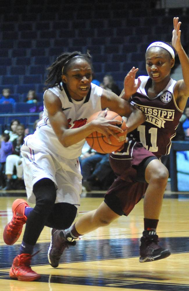 Mississippi's Valencia McFarland (3) drives against Mississippi State's Katia May (11) during an NCAA college basketball game Thursday, Jan. 23, 2014, in Oxford, Miss