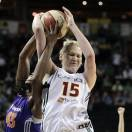 FILE - in this Sept. 19, 2011, file photo, Seattle Storm's Lauren Jackson (15) is fouled by Phoenix Mercury's Nakia Sanford during a WNBA basketball game in Seattle. Because of injuries and national team commitments, the Storm became used to Jackson being absent at times for the last few seasons. But even when Jackson was gone, Sue Bird was almost always there. That won't be the case in 2013 with both Bird and Jackson sidelined for the season recovering surgeries that leave the Storm with major questions. (AP Photo/Elaine Thompson, File)