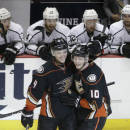 Anaheim Ducks' Corey Perry, right, celebrates his goal with Cam Fowler in front of Los Angeles Kings players during the third period of an NHL hockey game, Friday, Feb. 27, 2015, in Anaheim, Calif. The Ducks won 4-2. (AP Photo/Jae C. Hong)