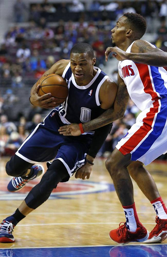 Oklahoma City Thunder guard Russell Westbrook, left, makes a drive on Detroit Pistons guard Brandon Jennings, right, in the first half of an NBA basketball game in Detroit, Friday, Nov. 8, 2013