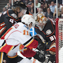 Ducks' goaltender Frederik Andersen gets some help from the goal post as Hampus Lindholm defends against Calgary's Mikael Backlund during Anaheim's 6-3 victory over the Flames at Honda Center Wednesday night Jan. 21, 2015 The Associated Press
