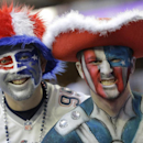 New England Patriot fans pose for a picture before the NFL Super Bowl XLIX football game against the Seattle Seahawks Sunday, Feb. 1, 2015, in Glendale, Ariz The Associated Press